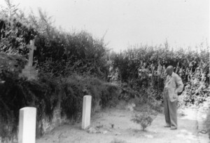 Billy Beach's father looks on at his son's grave post war.