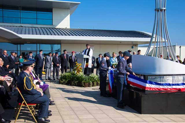 Two Guernsey Air Cadets to a drum roll ceremoniously unveil the names.