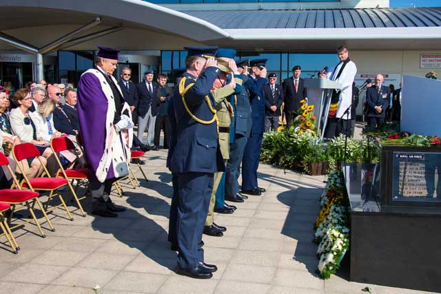 The six air attaches of the RAF, RCAF, RAAF, RNAF, USA and Czech Republic laying their wreaths after the Bailiff salute the memorial.